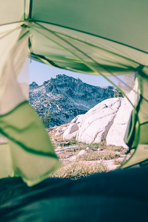 Peeking out of my tent on a summer backpacking trip in the Enchantments, Washington.