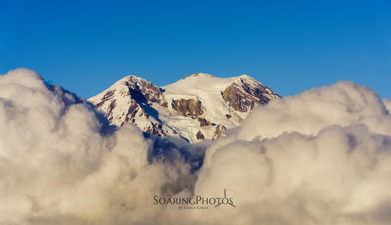 """Rainier """"peeking"""" through the clouds"""