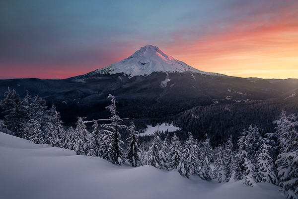 A vibrant sunrise lights up Mount Hood seen from Tom Dick and Harry Mountain - Oregon