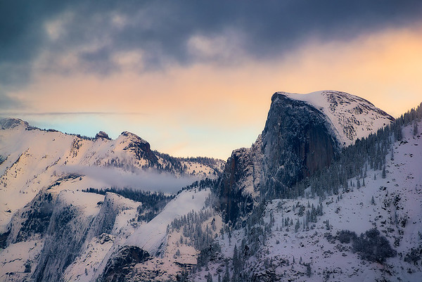 Sunset over a freshly snowy Half Dome - Yosemite, California