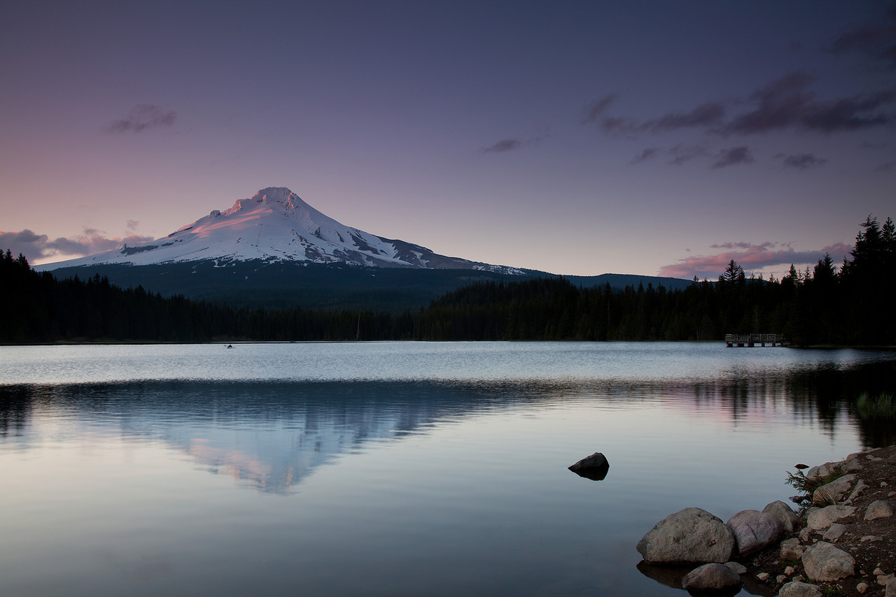 Last Paddle - A lone kayaker enjoys the solitude on Trillium Lake as the sun sets to the West of Mount Hood.