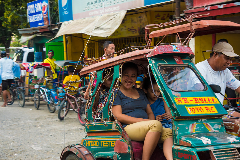 Happy lady on colorful trike