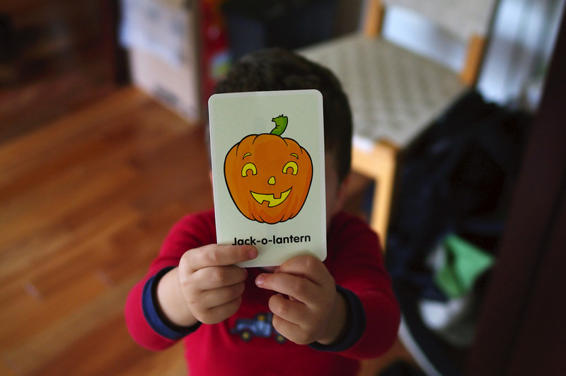 if, like me, you don't have kids, you might think this was a posed shot.  nope!  he just wanted to show me the jack-o-lantern card.