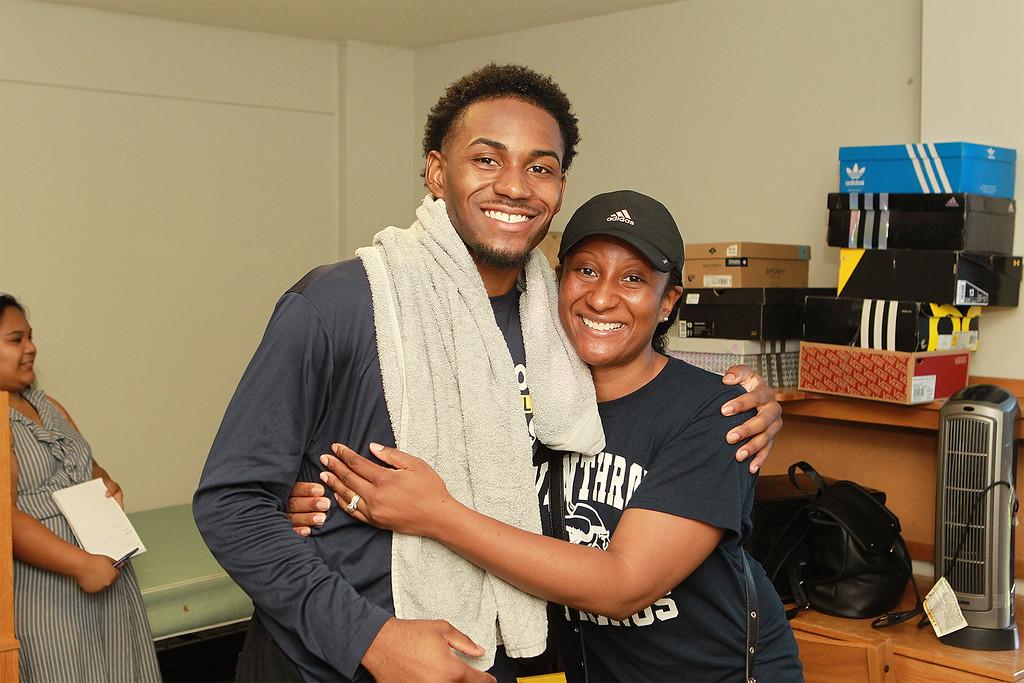 . Tayjuan McKenzie from Lynn gets a hug from his mother SENTINEL&ENTERPRISE/Scott LaPrade