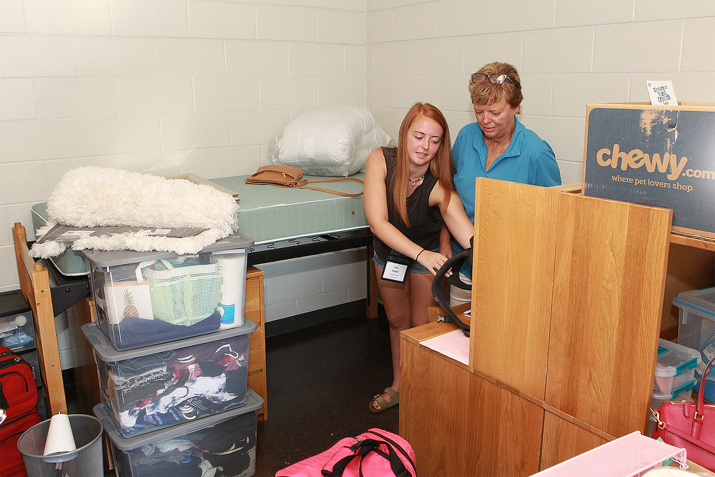 . Erin Mader from Tewskbury and her mom Lisa start to unpack SENTINEL&ENTERPRISE/Scott LaPrade