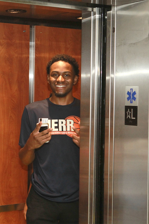 . Tayjuan McKenzie from Lynn all smiles as he takes the elevator to his new room SENTINEL&ENTERPRISE/Scott LaPrade