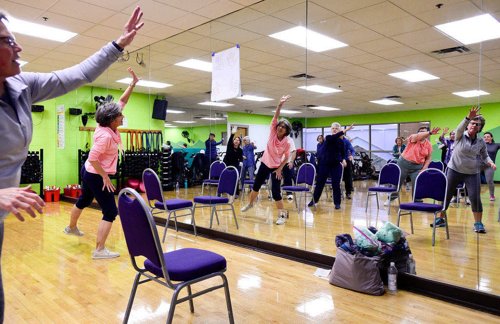 . Instructor Nancy Hillmer leads a Move it! Improve it! workout at Louisville Recreation and Senior Center in Louisville, Colorado on Jan. 10, 2018.  (Photo by Matthew Jonas/Times-Call)