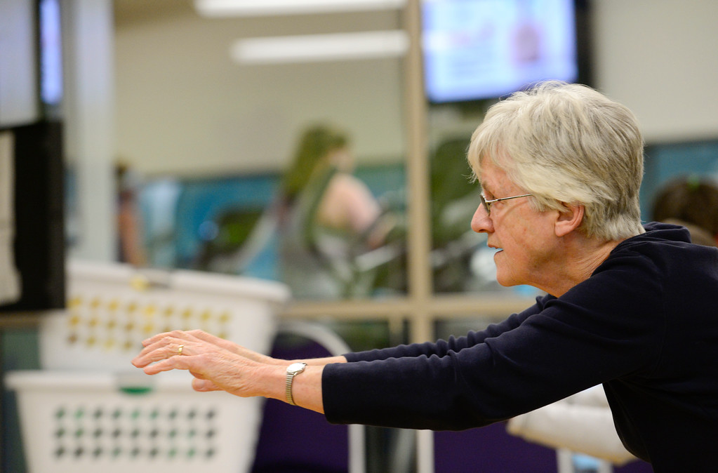 . Ilse Bleck, of Boulder, stretches during a Move it! Improve it! workout at Louisville Recreation and Senior Center in Louisville, Colorado on Jan. 10, 2018.  (Photo by Matthew Jonas/Times-Call)