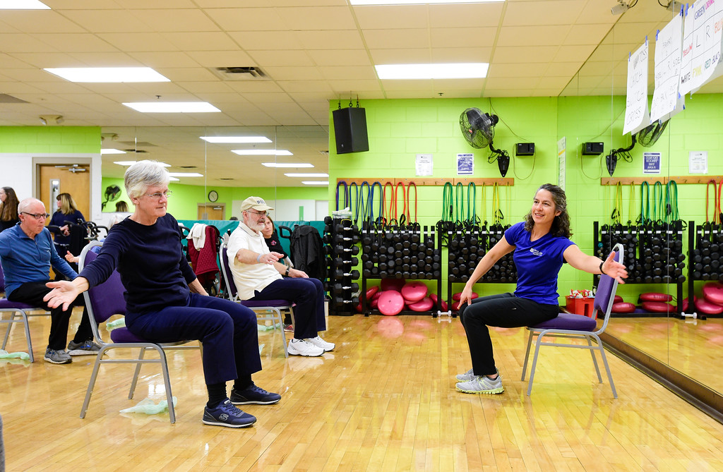 . Instructor Anastasia Benson, right, leads a group in warmups during a Move it! Improve it! workout at Louisville Recreation and Senior Center in Louisville, Colorado on Jan. 10, 2018.  (Photo by Matthew Jonas/Times-Call)