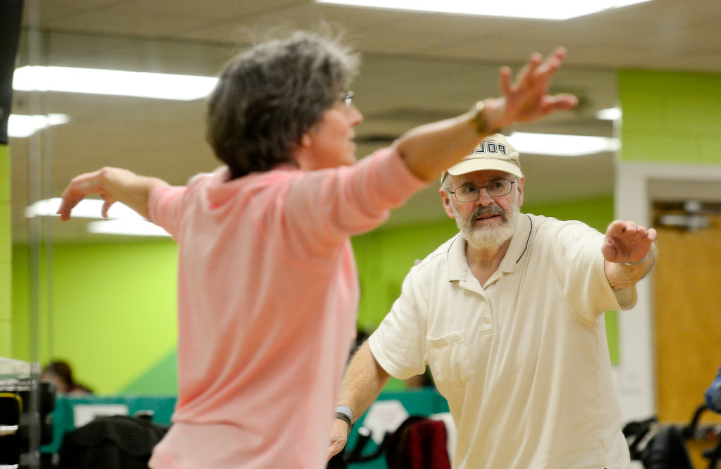 . Roy Davis, of Louisville, right, follows along as Instructor Nancy Hillmer leads a Move it! Improve it! workout at Louisville Recreation and Senior Center in Louisville, Colorado on Jan. 10, 2018.  (Photo by Matthew Jonas/Times-Call)