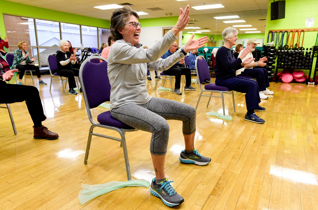 . Sandy Berman, of Lafayette, laughs during a Move it! Improve it! workout at Louisville Recreation and Senior Center in Louisville, Colorado on Jan. 10, 2018.  (Photo by Matthew Jonas/Times-Call)
