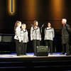 Bob Kerdus introduces Indigo Quartet -- Julie Schlader, Jill Perkins, Sue Schellenberg, and Paula Land. TheHarmony Hawks Gospel Concert was held Friday,  Nov. 1, 2013 at the New Covenant Bible Church.
