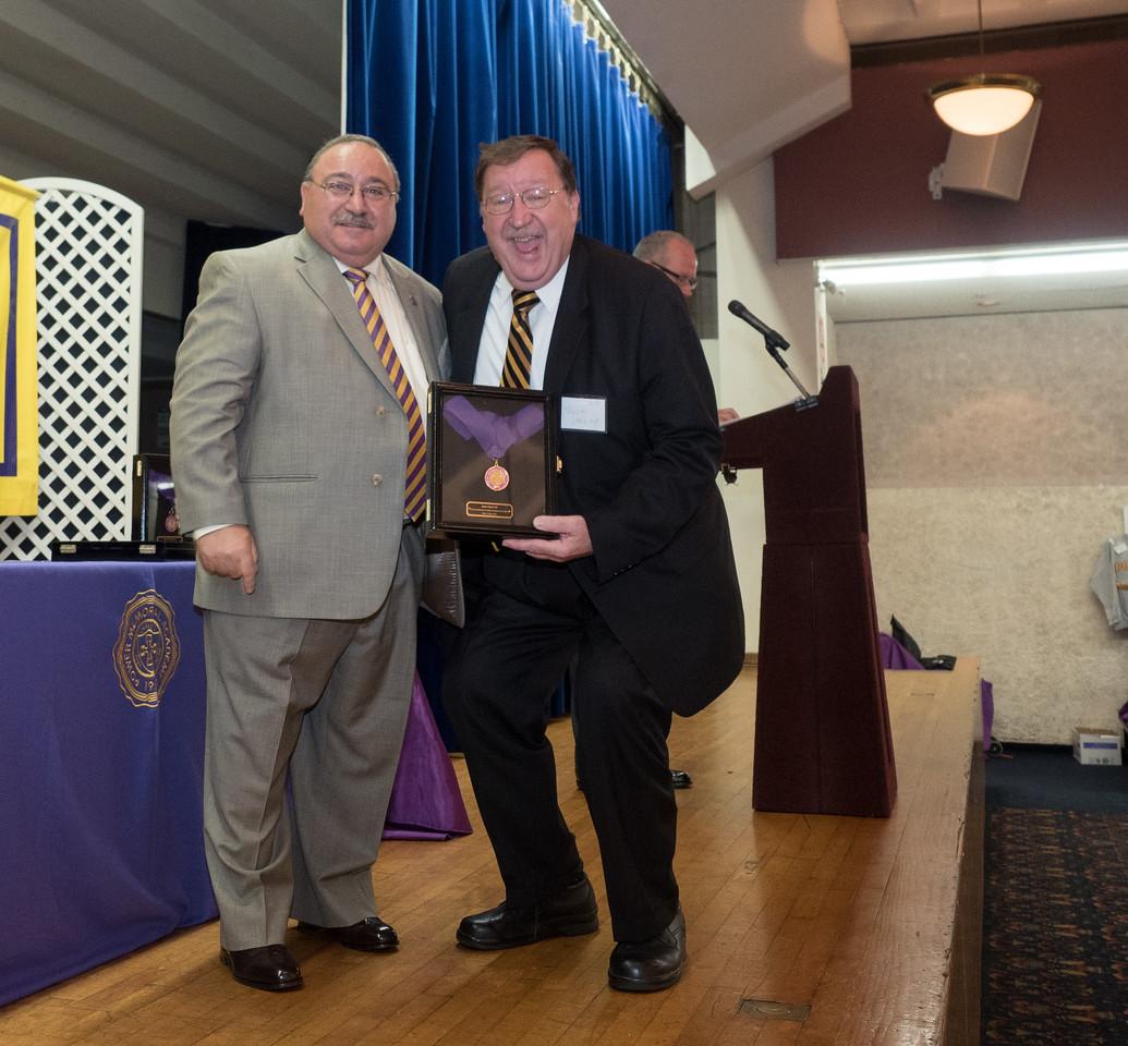 Norman Jardine, PMA'65 accepts the HOF Award for James W. Reed, PMA'65