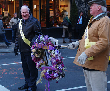 Bill Cassidy and Frank Cassidy, Class of 1955, carrying the memorial wreath marking the 60th anniversary of the death of  Thomas Brady, a PMA student who was shot and killed March 15, 1948 while practicing for the Parade.