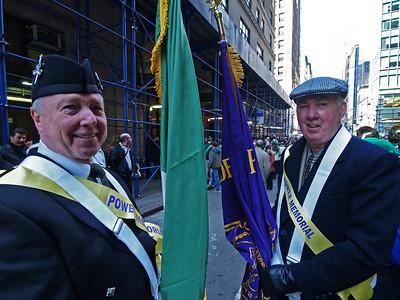 Irish flag bearer Jack Haren '65 and Power flag bearer John Minton '61