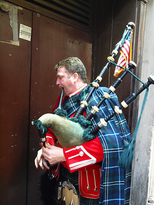 Brian Kearny warms up for his second trip up Fifth Avenue. (He is a piper in the NYFD pipe band)
