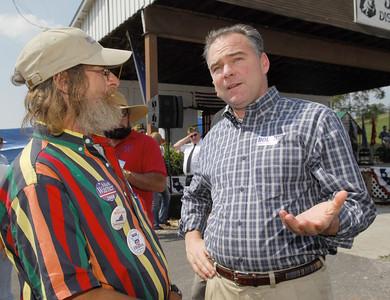 Photo Earl Neikirk/Bristol Herald Courier  Virginia Gov. Tim Kaine talks with Bill Reeves from Wise, VA at the  UMWA Fish Fry in Castlewood, Va.