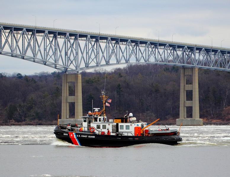 U.S Coast Guard on the Hudson River January 25th 2012 near Kingston NY. The Kingston-Rhinecliff Bridge is in the background.