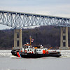 U.S Coast Guard on the Hudson River January 25th 2012 near Kingston NY. The Kingston-Rhinecliff Bridge is in the background.