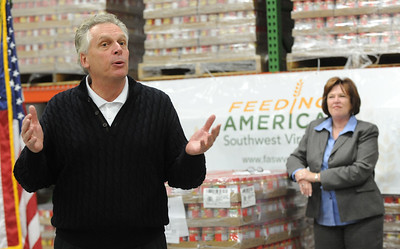 Gov. elect Terry McAuliffe speaks to volunteers gathered at the Feeding America Southwest Virginia food pantry during McAuliffe's pre Inaugural activities on Saturday, January 4, 2014 in Abingdon, Va.  President and CEO Feeding America Southwest Virginia Pamela Irvine is shown in background.