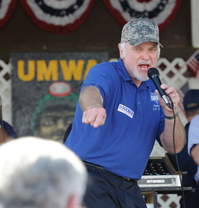 Photo Earl Neikirk/Bristol Herald Courier  UMWA President Cecil Roberts talks to union members about Rick Boucher during the  UMWA meeting and meal in Castlewood, Va. at the Russell County Fairgrounds on Saturday.