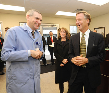 EARL NEIKIRK/BRISTOL HERALD COURIER  Gov. Elect Bill Haslam, right, talks with Robert Scharf, President of Protokraft on Monday, Jan. 10, 2011 in Kingsport, Tn.  Haslam has spent the day making stops in Johnson City and Kingsport.  Crissy Haslam is in center back.