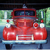 This is a scanned image from a 4x6 35mm photograph. Probably 20 years old. Old Dodge Firetruck.