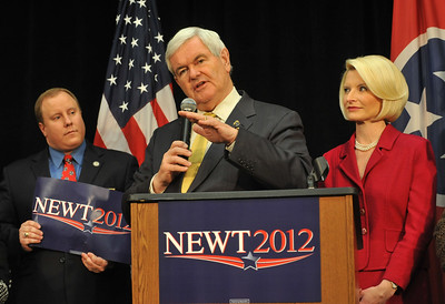 Earl Neikirk/Bristol Herald Courier  Republican Presidential candidate Newt Gingrich speaks to the Greater Kingsport Republican Women's Club on Monday as his wife Callista, right, and Matthew Johnson, Sullivan County commissioner, left, look on.