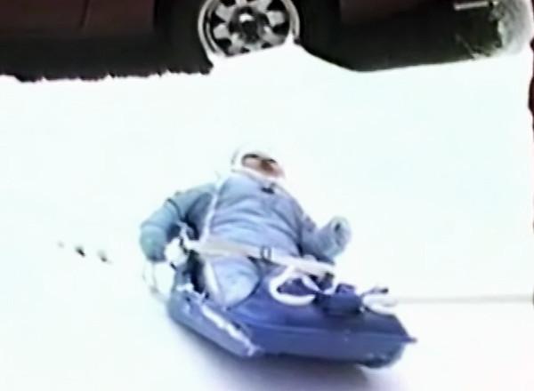 Frankie in snow sled
