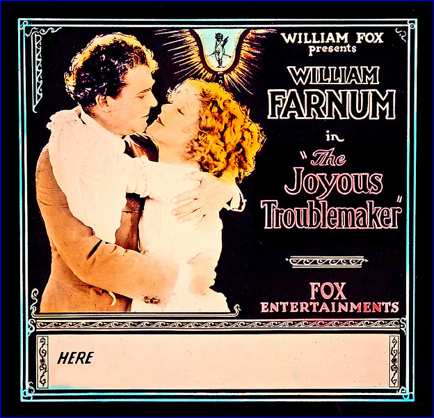 """The Joyous Troublemaker (1920) <br /> <br /> Synopsis: """"When William Steele, a rich young businessman with a passion for vacation outings, purchases his favorite resort, the sale is contested by the spirited Beatrice Corlin, who believes that the property lies on her land. Beatrice presents Steele with a challenge: if he succeeds in building a cabin on the land, she will cook him a dinner. Beatrice enlists the aid of Joe Embry to win the bet, and after several clashes between Embry and Steele, Embry abducts Beatrice. Steele, learning of his treachery, rescues her. Finally realizing their love for each other, Steele and Beatrice cancel the bet by merging their land in marriage."""" -  <a href=""""http://www.tcm.com/tcmdb/title.jsp?stid=496050"""">http://www.tcm.com/tcmdb/title.jsp?stid=496050</a>"""