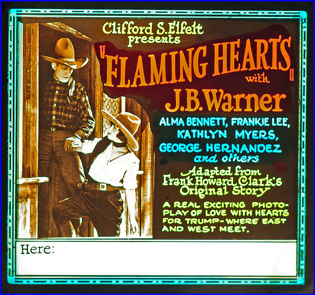 """Flaming Hearts (1922)<br /> <br /> Synopsis: """"Jeff Hartman, society lap-dog, goes West to make a man of himself. En route aboard box-car [he] captures two tramps who have stolen payroll. Hands them over to sheriff and gets himself in solid. Tenderfoot develops after much adversity into cowboy. At county fair Hartman wins raffle, the reward being a kiss from Marion Barrows, the sheriff's daughter. Hartman, fearful of taking the privilege, flees. Sheriff and daughter angered by insult. Fair receipts missing. Suspicion centers on Hartman. Marion discovers Jeff in shack and at point of gun leads him to her father. Revealed that sheriff's little nephew has taken bag holding Fair's receipts to play with them. Jeff and Marion reunited."""" ( Motion Picture News Booking Guide, 4:49, Apr 1923.)"""" - <br />  <a href=""""http://www.tcm.com/tcmdb/title.jsp?stid=494536"""">http://www.tcm.com/tcmdb/title.jsp?stid=494536</a>"""