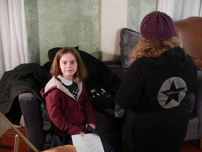 Eva preparing for her scene as the little girl.