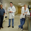 """Production crews from Los Angeles were at Heywood Hospital in Gardner on Thursday afternoon to film an independent television pilot. The show, named """"Deaths Door"""" is based on a book by Massachusetts doctor Sebastian Sepulveda,  a primary care/nephrologist from Chelmsford. Sepulveda, left, watches scenes along with actors Tom Malloy and Ellen Hollman. SENTINEL & ENTERPRISE / Ashley Green"""