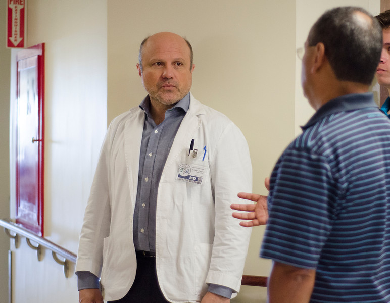 """Production crews from Los Angeles were at Heywood Hospital in Gardner on Thursday afternoon to film an independent television pilot. The show, named """"Deaths Door"""" is based on a book by Massachusetts doctor Sebastian Sepulveda, a primary care/nephrologist from Chelmsford. Actor Enrico Colantoni, playing Dr. Mark Corbin, speaks with Sepulveda between scenes. SENTINEL & ENTERPRISE / Ashley Green"""
