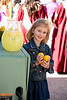"Madison Bentley, daughter of Little Faith Pictures CEO ""MJ"" Bentley, poses with props from her lemonade stand."