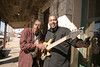 "Actor Ernie Hudson plays around between takes with bassist Frank Sutton. The band played a chorus of ""Ghostbusters"" in between takes in recognition of Hudson's role in the movie."