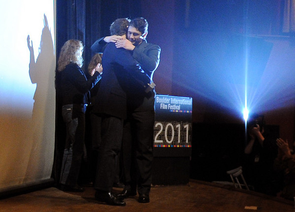 Aron Ralston, left, gets a hug from James Franco.<br /> Actor James Franco was a special guest  and BIFF Vanguard Award winner at the Boulder International Film Festival (BIFF) on Saturday night at the Boulder Theater.<br /> Cliff Grassmick/ February 19, 2011