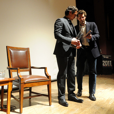 James Franco, left, gets a book from Aron Ralston before the Q and A.<br /> Actor James Franco was a special guest  and BIFF Vanguard Award winner at the Boulder International Film Festival (BIFF) on Saturday night at the Boulder Theater.<br /> Cliff Grassmick/ February 19, 2011