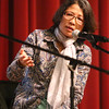 """Panelist Thida Loeung, a kindergarden teacher in the Lowell publiic schools, speaks afte a free screening of """"First They Killed My Father,"""" a Netflix film about the Khmer Rouge genocide, directed by Angelina Jolie, at Lowell High.  (SUN/Julia Malakie)"""