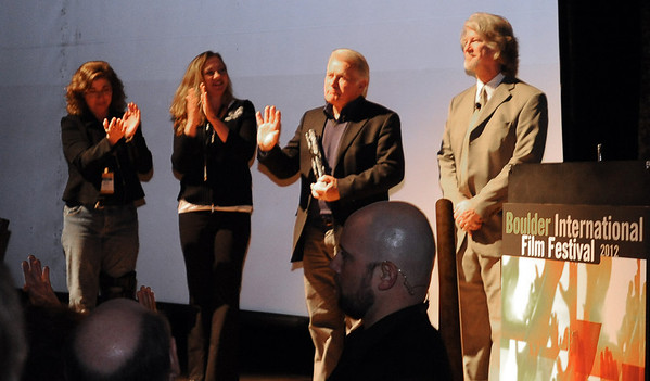 "Martin Sheen receives his award from Kathy Beeck, left,  Executive Director of BIFF, Robin Beeck, Festival Director of BIFF, and Ron Bostwick, host.<br /> Distinguished actor, Martin Sheen, was the 2012  Boulder International Film Festival winner of the Master of Cinema Award.<br /> For a video and photos of Sheen, go to  <a href=""http://www.dailycamera.com"">http://www.dailycamera.com</a>.<br /> Cliff Grassmick / February 18, 2012"