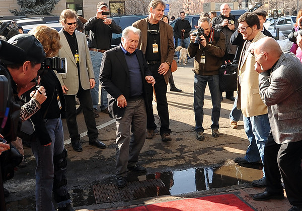 "Martin Sheen does a little dance before stepping over a puddle at the Boulder Theater on Saturday.<br /> Distinguished actor, Martin Sheen, was the 2012  Boulder International Film Festival winner of the Master of Cinema Award.<br /> For a video and photos of Sheen, go to  <a href=""http://www.dailycamera.com"">http://www.dailycamera.com</a>.<br /> Cliff Grassmick / February 18, 2012"