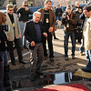 """Martin Sheen does a little dance before stepping over a puddle at the Boulder Theater on Saturday.<br /> Distinguished actor, Martin Sheen, was the 2012  Boulder International Film Festival winner of the Master of Cinema Award.<br /> For a video and photos of Sheen, go to  <a href=""""http://www.dailycamera.com"""">http://www.dailycamera.com</a>.<br /> Cliff Grassmick / February 18, 2012"""