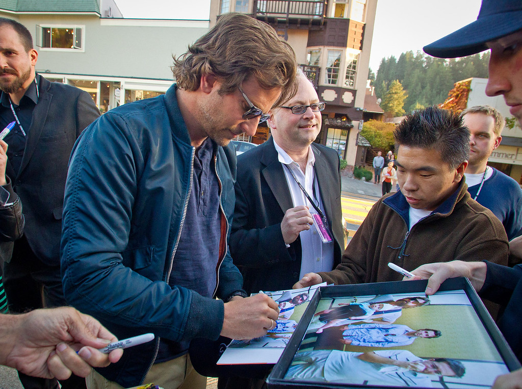 Actor Bradley Cooper signs autographs as he arrives at the opening of the Mill Valley Film Festival in Mill Valley, Calif., is seen on Thursday, Oct. 4th, 2012.