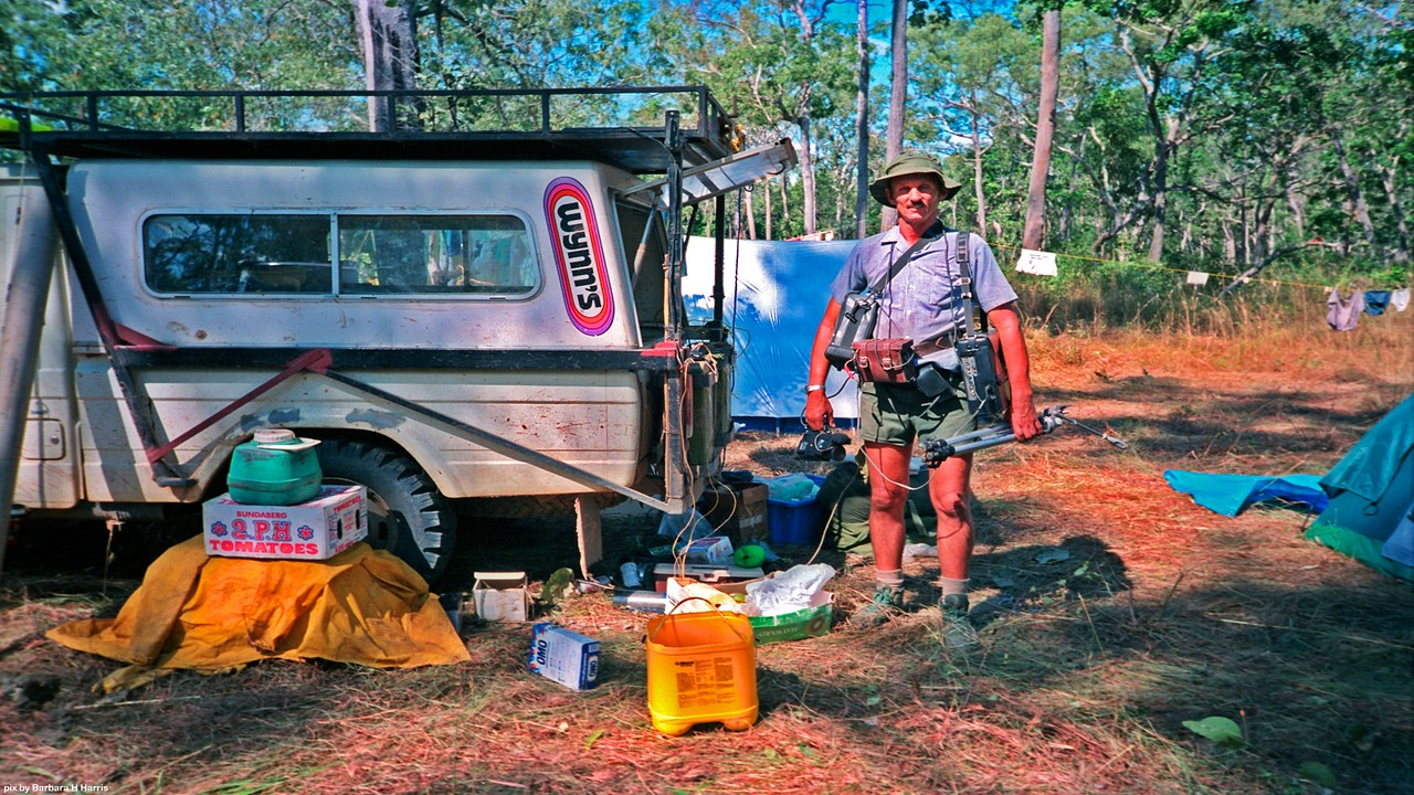 Brian with video camera on lead to Panasonic AG-6400 VHS video recorder powered by wet cell motor cycle battery on belt in leather case. Solar charging panel on roof rack. No power north of Wenlock.