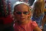 """""""What are you Julie?""""  This one is very short, and hard to tell what she is saying.  But she just picked out these super cool sunglasses in the store at Dorney Park, and is explaining that she is now a rock star."""