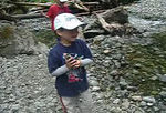 """""""Aunt Jenny, look at this""""  Miles picks the big rocks to throw."""