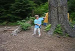"""""""Poking Bugs""""  Miles and his super sense of humor!  This was on his first backpacking trip. He borrowed my poles to """"poke bugs""""!"""