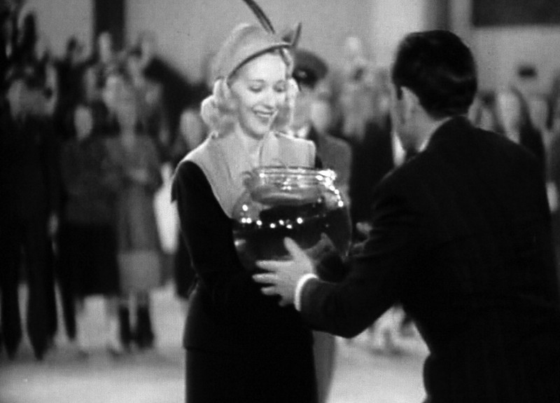 In There Goes My Heart (1938) Virginia Bruce as the main character wins her prize, a fishbowl.