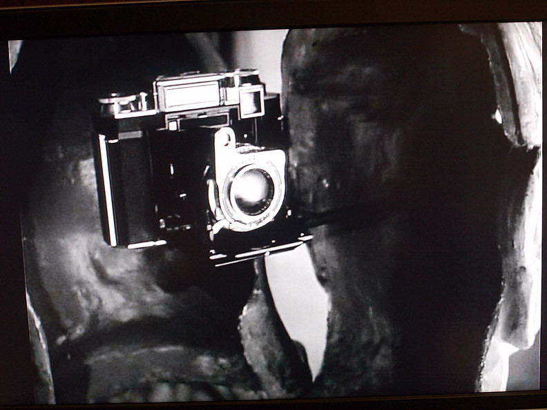 "A close-up of the camera in The Big Sleep, a Zeiss Ikon. How did it take secret pictures? It is never told in the movie how it worked, After all this is a crime film (one of the best in the film noir style) not a ""How to Take Secret Photos"" instructional film!"