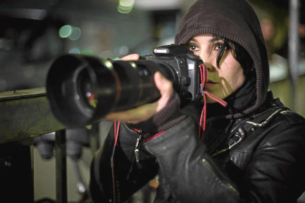 Noomi Rapace is computer hacker Lisbeth Salander in the movie The Girl with the Dragon Tattoo. She is an all around talented nerd, even using a camera in the film.